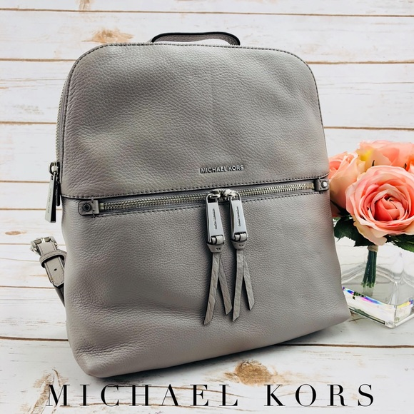 ebce72518ef4 Michael Kors Rhea Zip Medium Slim Backpack. M_5ad656f0739d48c78750a4fa